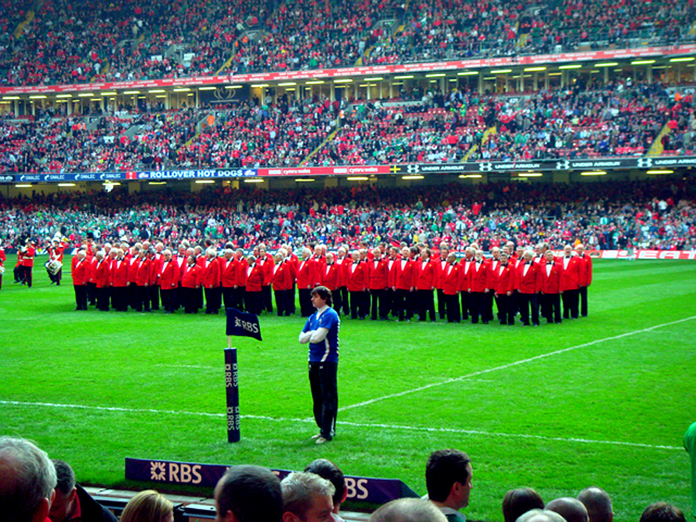 About-us-2-Choir-on-rugby-pitchx.jpg#ass